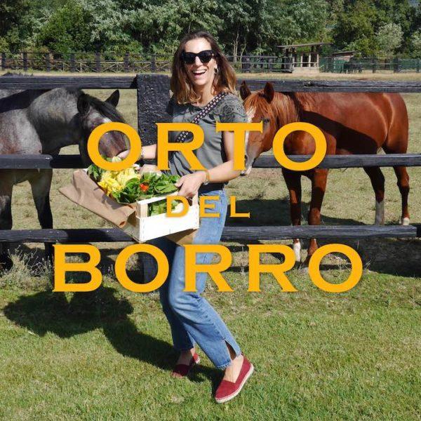 Alice avec des cheveaux en Italie à Orto dell Borro
